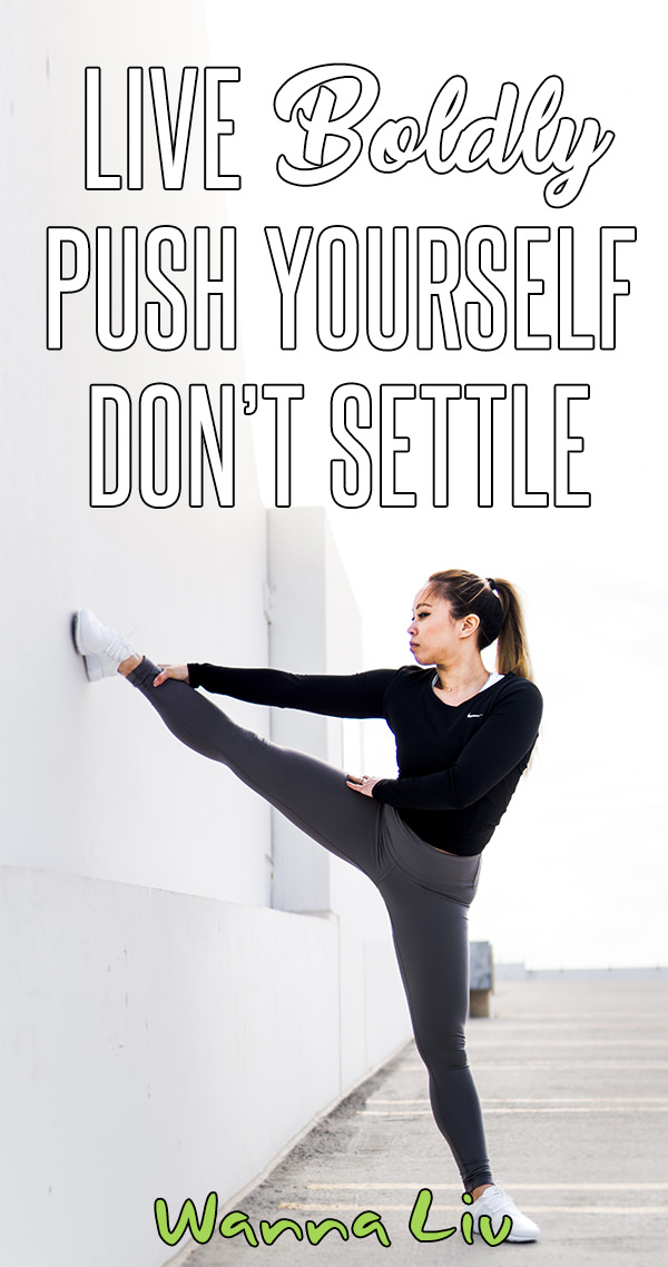 """Woman outside stretching her leg on a wall with overlay text """"Live Boldly 
