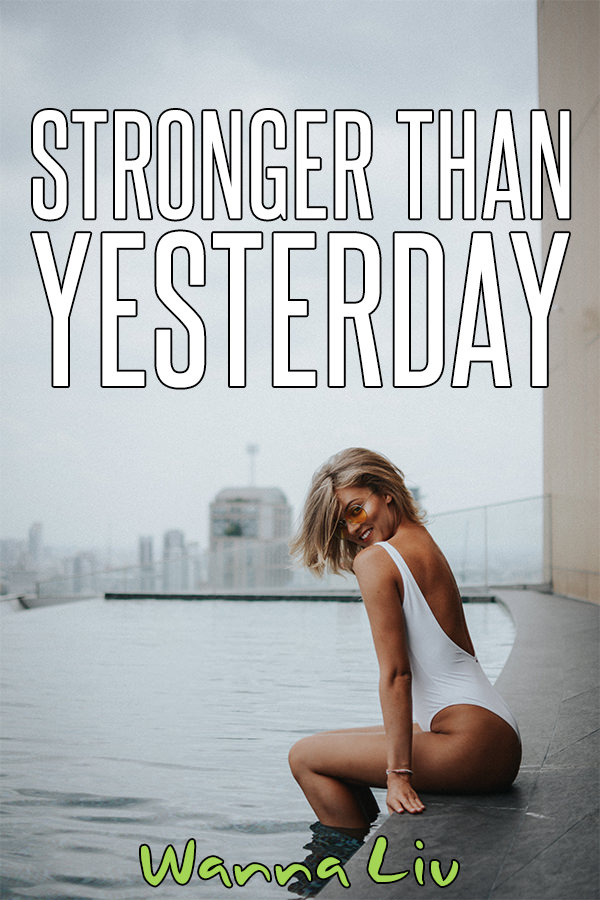 """Attractive woman sitting poolside with overlay text """"Stronger Than Yesterday"""""""
